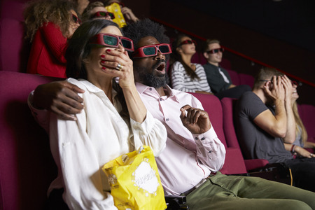 Couple In Cinema Wearing 3D Glasses Watching Comedy Film Stock Photo