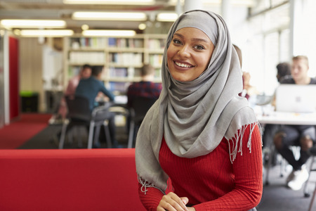 muslim: Portrait Of Female University Student Working In Library