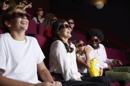 cinema film: Audience In Cinema Wearing 3D Glasses Watching Comedy Film