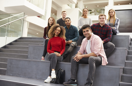 campus building: Portrait Of Student Group On Steps Of Campus Building