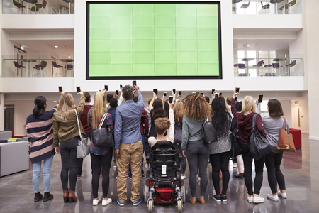 Students photograph screen with phones, back view full length Stok Fotoğraf