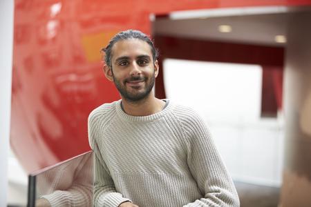 Asian male student in modern university building, portrait