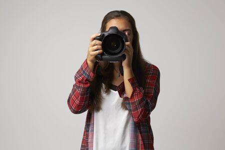 Studio Portrait Of Female Photographer With Camera Stock Photo