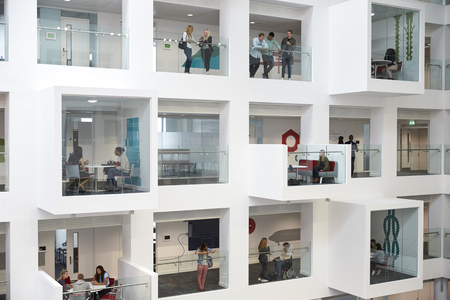 view of an atrium in a building: University atrium, rooms and balconies, seen from mezzanine