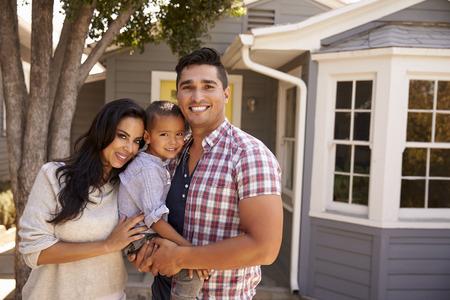 Portrait Of Family Standing Outside Home Stock fotó