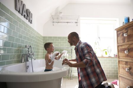 bath time: Father And Son Having Fun At Bath Time Together Stock Photo