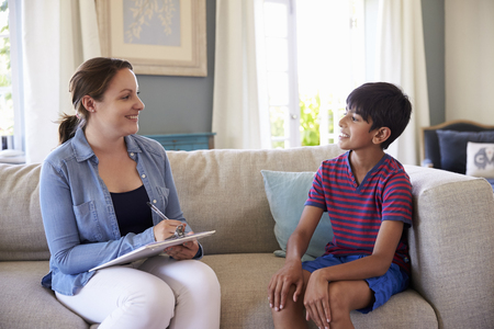 counsellor: Young Boy Talking With Counselor At Home