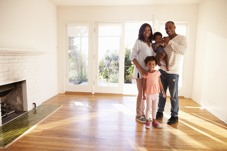 Portrait Of Family In New Home On Moving Day Stock Photo