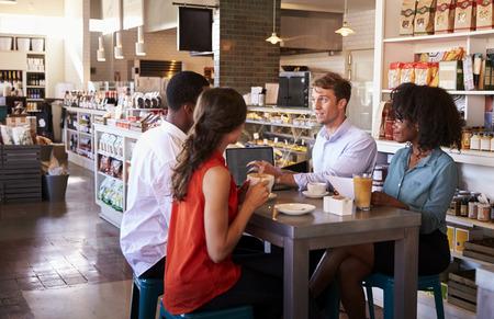 informal: Business Group Having Informal Meeting In Cafe