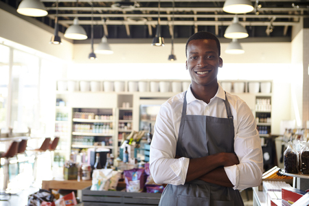 Portrait Of Male Employee Working In Delicatessen Stock Photo