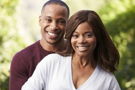 african america: Outdoor Head And Shoulders Portrait Of Romantic Couple Stock Photo