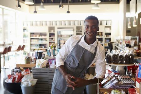 Portrait Of Male Employee Working In Delicatessen Stock Photo