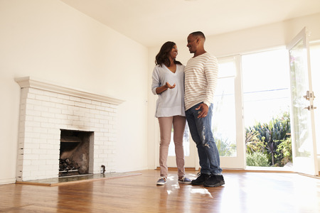black: Excited Couple Explore New Home On Moving Day