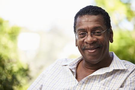 african america: Outdoor Head And Shoulders Portrait Of Senior Man