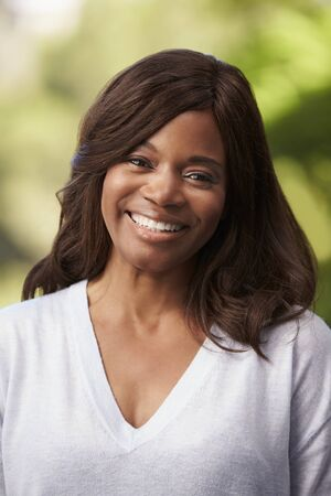 african america: Outdoor Head And Shoulders Portrait Of Woman Stock Photo