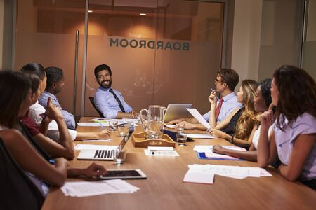 Relaxed moment at an evening corporate business meeting Stock Photo