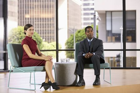 smartly: Smartly dressed man and woman on set for a TV interview