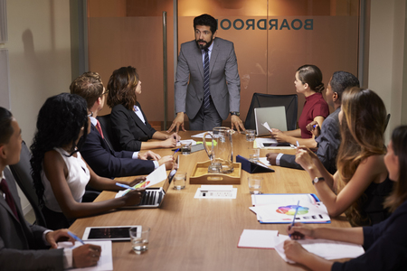 Businessman addressing colleagues at a boardroom meeting