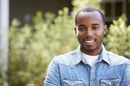 and the horizontal man: Happy young African American man in denim shirt, horizontal
