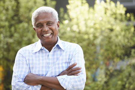 Smiling senior African American man with arms crossed Stock Photo
