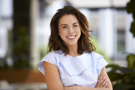 filipino ethnicity: Close up of young mixed race businesswoman looking at camera Stock Photo