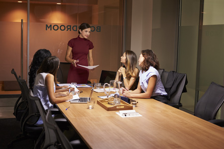 only women: Female boss and colleagues at an evening business meeting