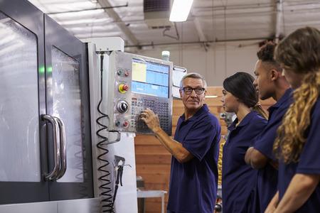 factory machine: Engineer Training Apprentices On CNC Machine