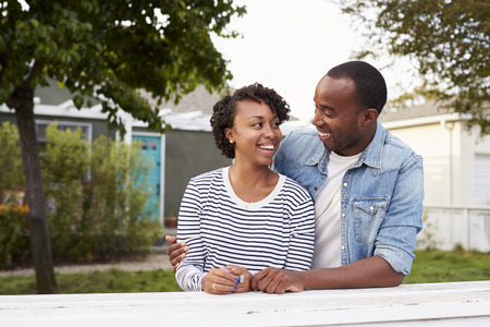 African American couple outside their new house Stock Photo
