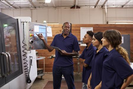 machinist: Engineer Training Apprentices On CNC Machine