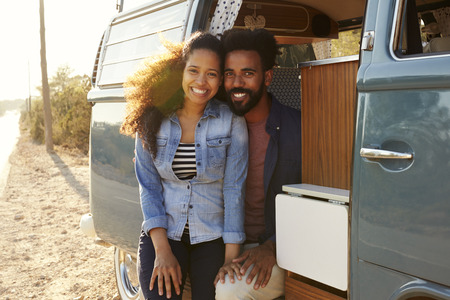 flare up: Couple making a roadside stop in their van look to camera
