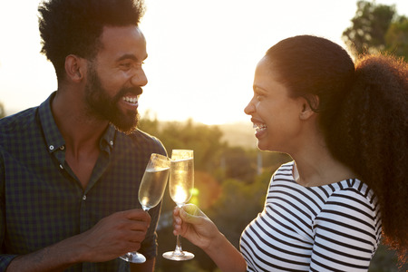 flare up: Romantic couple making a toast outdoors Stock Photo
