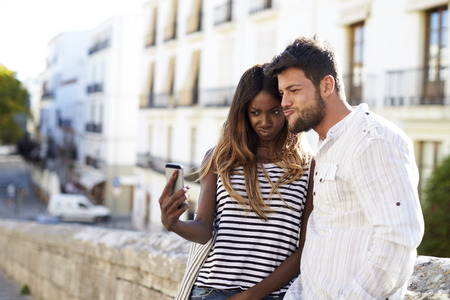 looking for love: Young adult couple posing for a selfie, Ibiza, Spain
