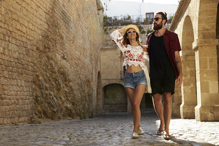 away from it all: Couple sightseeing old buildings on vacation, Ibiza, Spain Stock Photo