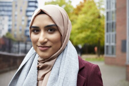 Portrait Of British Muslim Woman In Urban Environment Stock Photo