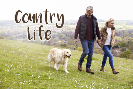 Country Life Couple Taking Dog For Walk