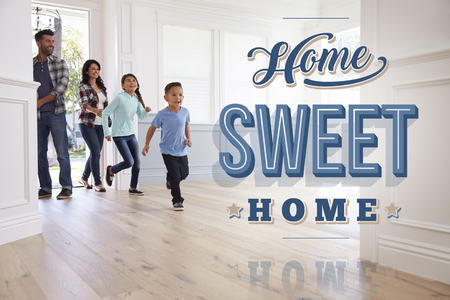 Hispanic Family In Their New Home Sweet Home Stock Photo