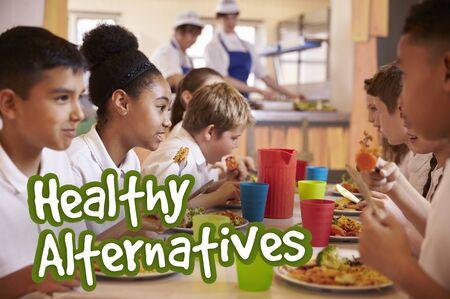 school cafeteria: School children eat healthy alternative meals