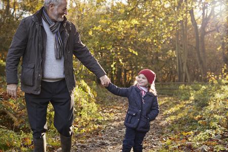 oxfordshire: Grandfather And Granddaughter Enjoying Autumn Walk