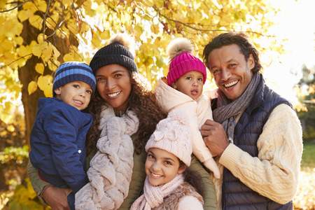 Outdoor Portrait Of Family In Autumn Landscape