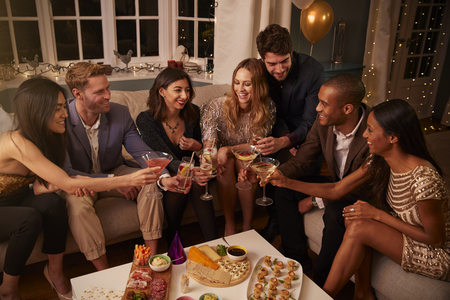 Friends eating snacks as they celebrate at a party together