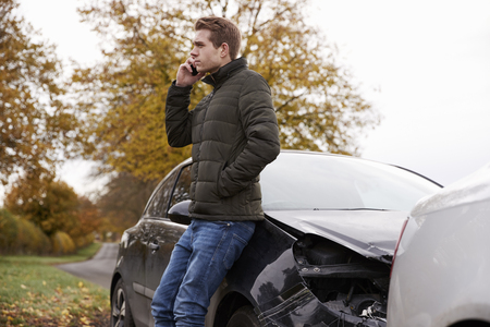 Man Calling To Report Car Accident On Country Road