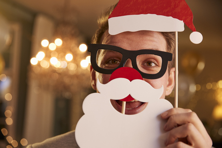 Young man dressing up with Santa props for Christmas party Stock Photo