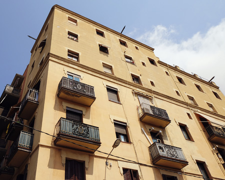 BARCELONA - JULY 29, 2016: Old corner building in Gothic Quarter, low angle view