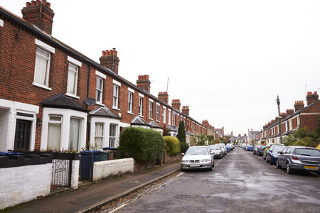 Exterior Of Victorian Terraced Houses In Oxford With Parked Cars