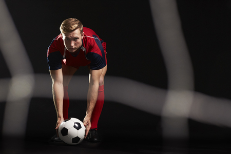 Professional Soccer Player Placing Ball For Penalty Kick Stock Photo