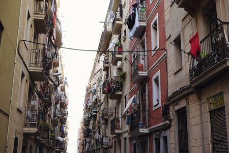View down a densely populated narrow residential street Фото со стока