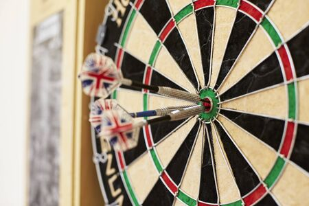 Close Up Of Dartboard With Three Darts In Bullseye Stock Photo