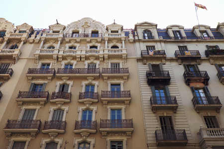 BARCELONA - JULY 29, 2016: Turn of the century building facades in the Gothic Quarter, low angle view Redakční