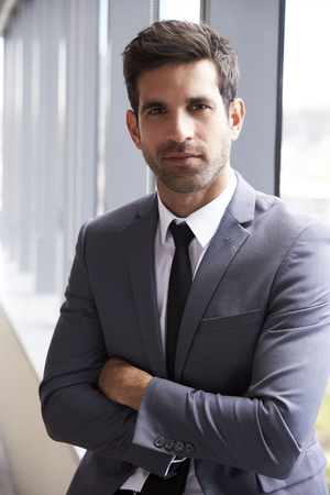 Head And Shoulders Portrait Of Young Businessman In Office Stock fotó