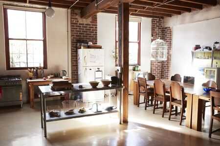 Serving Table In The Kitchen Dining Room Of A Loft Apartment Stock ...
